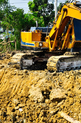 The operation of the excavator.