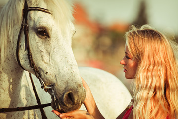 Young woman near the horse