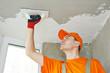 Plasterer at indoor ceiling work