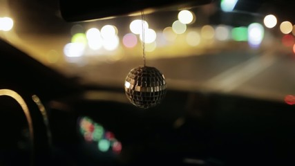 Disco ball hanging in the car