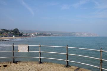 Cliffs beyond pier at Swanage in Dorset