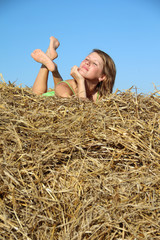 peasant girl resting in haystack