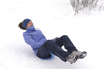 Girl riding on ice-board