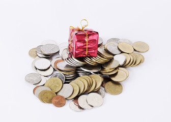 Red gift on coin money stack on white background