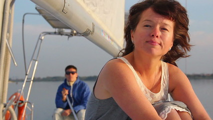 Woman feeling sad after a fight with partner, yachting, tourism