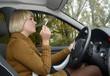 canvas print picture - junge Frau raucht im Auto,  Berlin, Deutschland