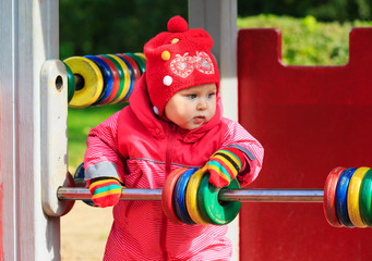 little girl playing with abacus on playground