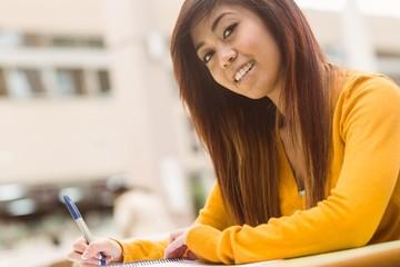 Female college student doing homework