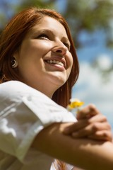 Portrait of a pretty redhead holding flowers