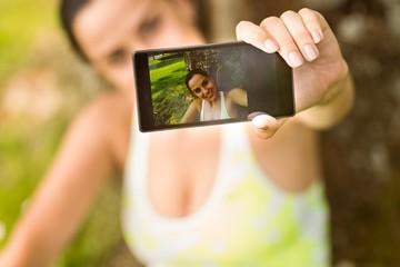 Fit brunette taking a selfie