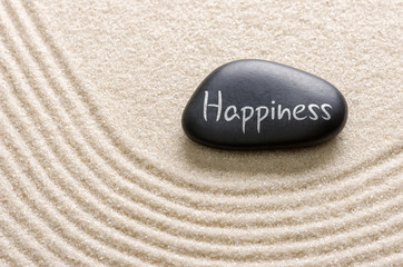 Black stone with the inscription Happiness