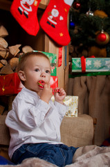 Little boy eating Christmas candy