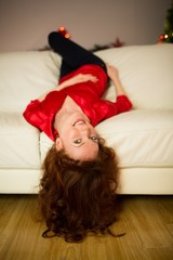 Pretty redhead lying on the couch