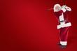 Leinwandbild Motiv Composite image of santa playing golf