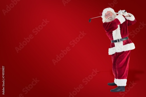 Composite image of santa playing golf - 74939817