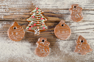 Christmas sweet gingerbread cookies on  wooden board