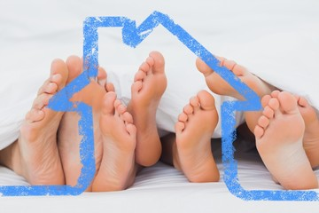 Composite image of feet of family sticking out from the quilt