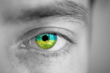 Men portrait with eyes the color of Ukrainian flag