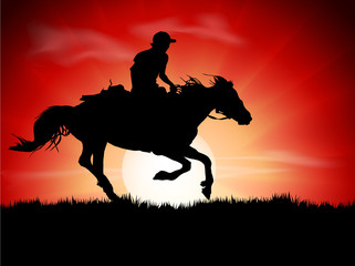 Silhouette of the equestrian of the jockey riding on sunrise