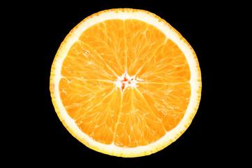 Slice of fresh orange on black background