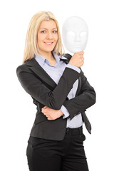 Businesswoman holding a theater mask