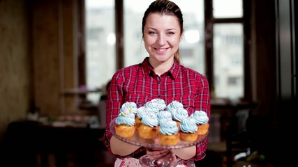 Pastry girl shows cupcakes for dessert