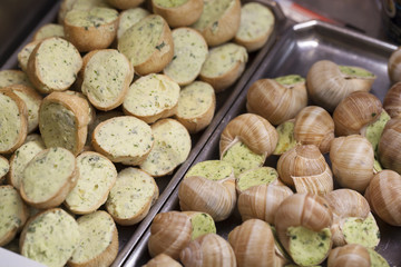 full and half snails with parsley and garlic butter