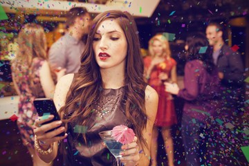 Composite image of pretty brunette sending a text