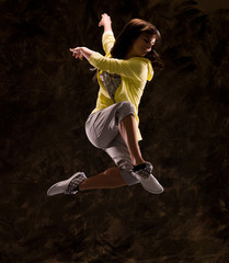 Modern hip-hop style teenage girl jumping
