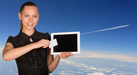 Beautiful businesswoman holding tablet PC and business card in