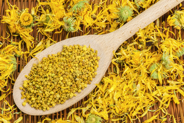 Bee pollen grains with dry yellow calendula