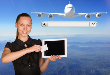 Beautiful businesswoman holding tablet PC. Beside are jet