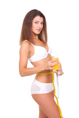 beautiful woman with measure tape over white