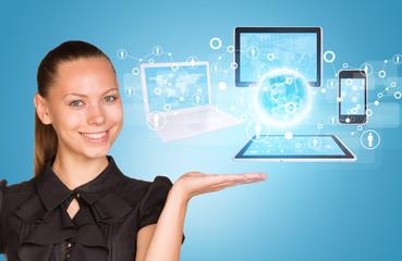 Beautiful businesswoman demonstrating computer equipment.