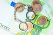 Euro money and  handcuffs closeup