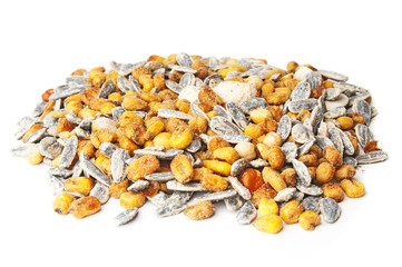 Sunflower seeds and corn grains on white background