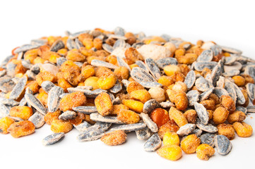 Sunflower seeds and corn grains closeup