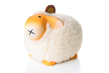 Sheep moneybox on white background