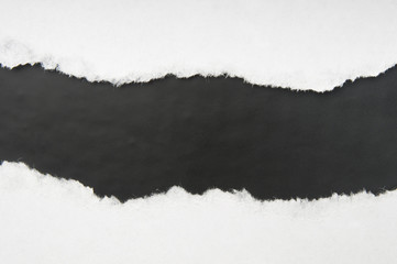 Torn white paper with black space