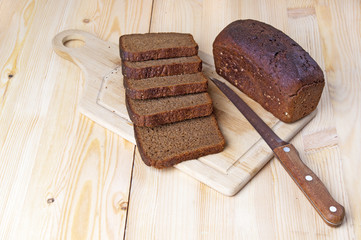 Slices of rye bread on wooden background