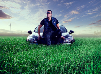 Man and car concept.Green grass landscape