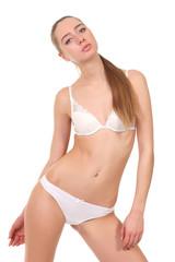 Beautiful female body in white underwear