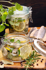 Herring marinated in oil with lemon and herbs