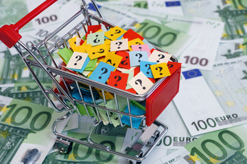 Shopping cart with question marks on one hundred euro banknotes