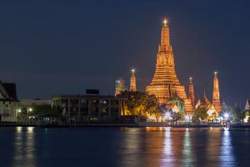 Wat Arun temple along with Bangkok river thailand