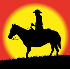cowboy al tramonto