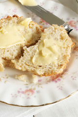 Freshly baked and buttered scones