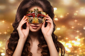 woman in a gold mask on a gold background