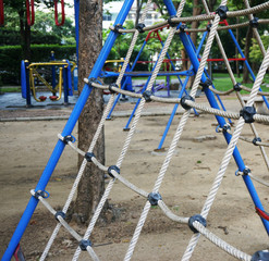 Climbing the net at the playground