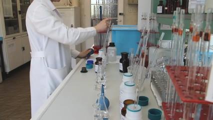 Biochemist tests water quality at sewage treatment plant lab